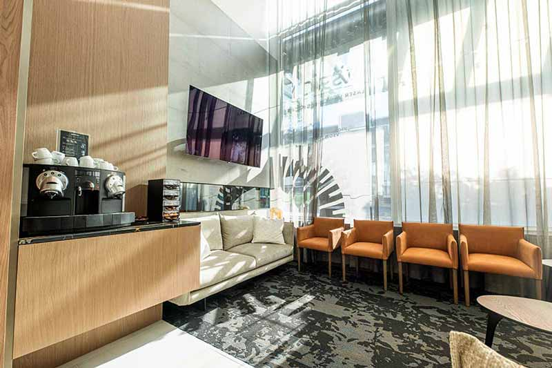 VSON laser eye surgery clinic coffee lounge with sofa, chairs, television and coffee machine